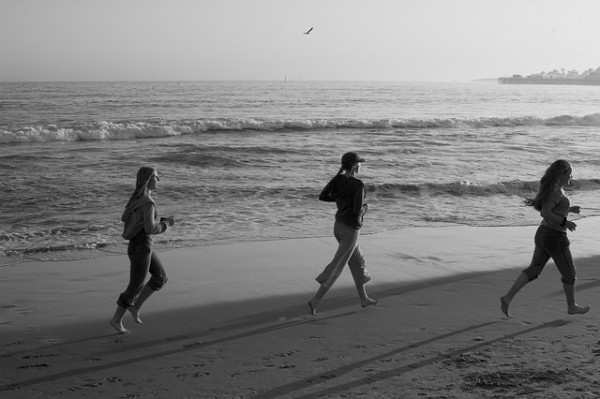 girls running on the beach