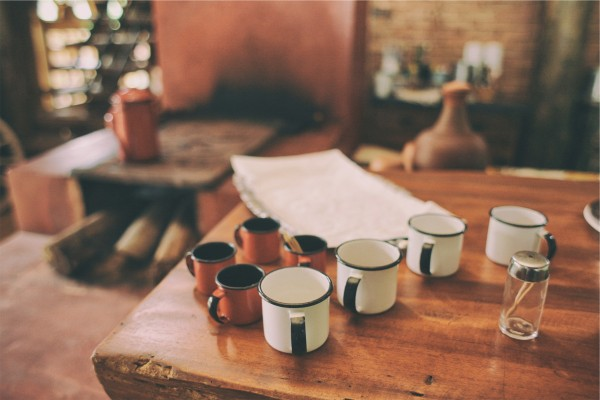 line of coffee cups on a table
