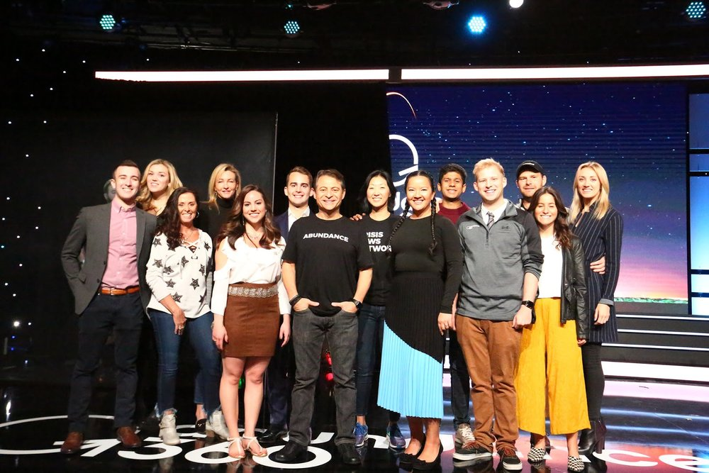 Pictured: Marissa with Peter Diamandis and the Abundance Group
