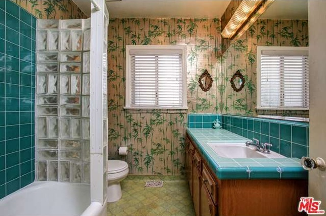 Bathroom Before.  That wallpaper!  Photo from MLS