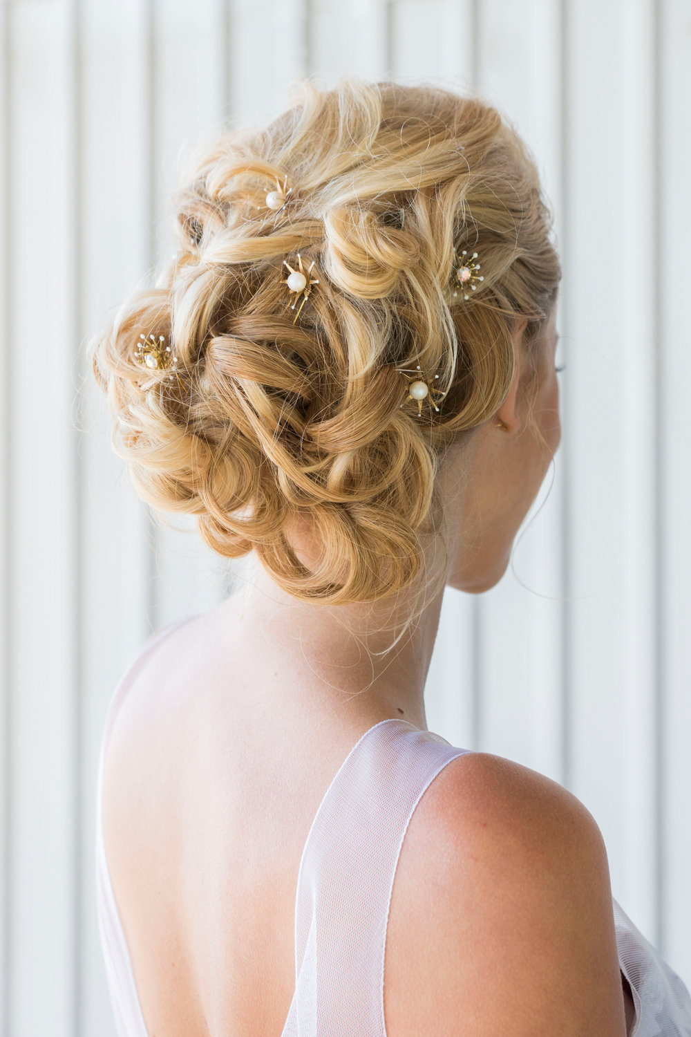 whimsical soft bridal updo.jpg