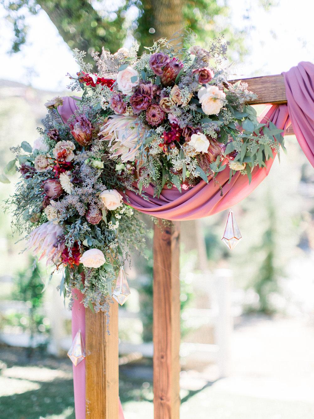 wedding arbor mauve florals.JPG