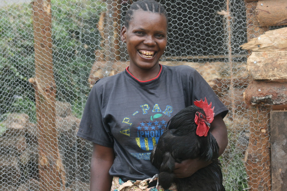 Yasinta with 'Robin the Rooster'