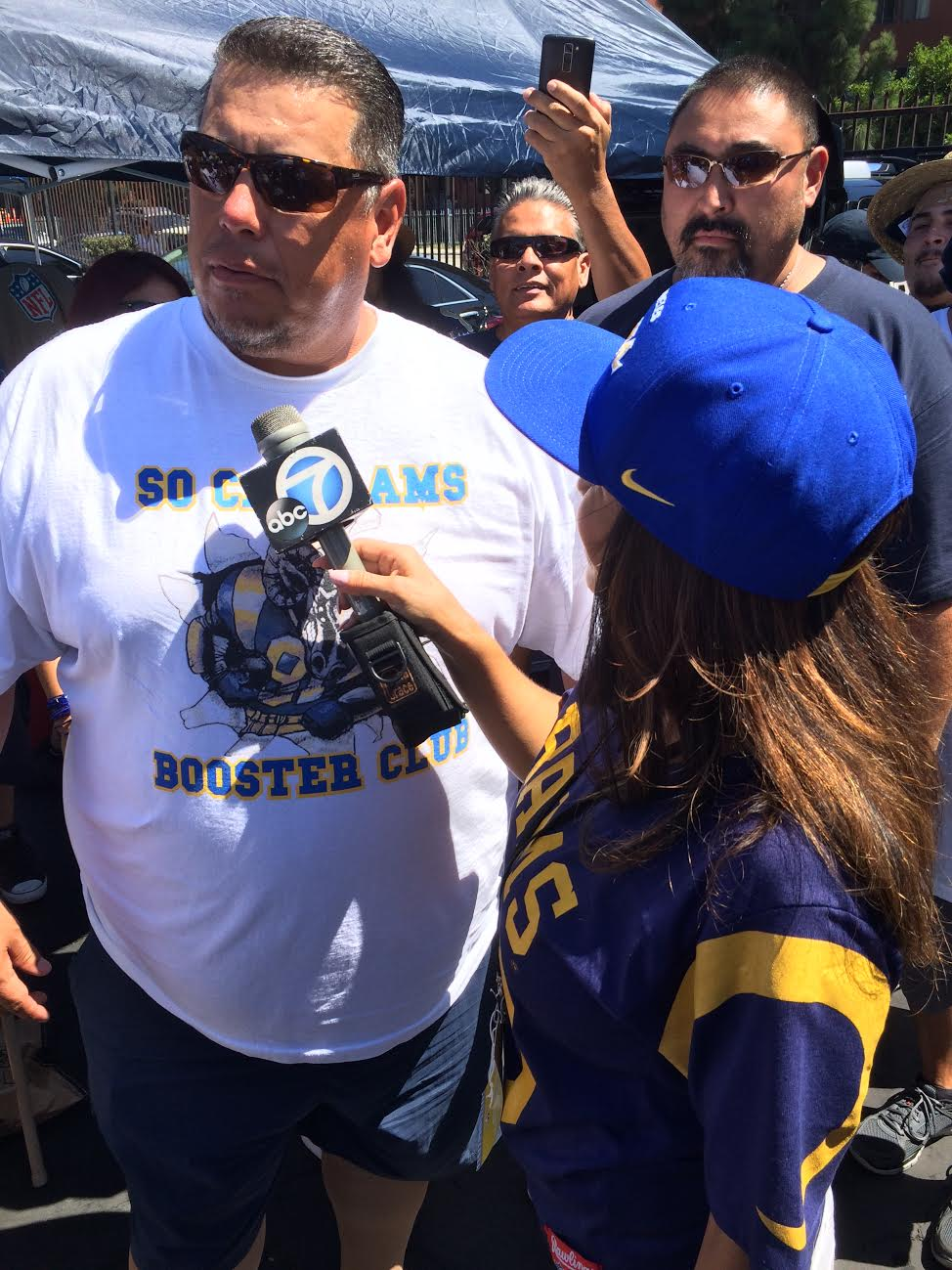 ABC's Ch.7 TV Personality  Alysha Del Valle  interviewing So Cal Rams Booster Club President  Ralph Valdez  at the Rams vs. Cowboys Tailgate (2016)