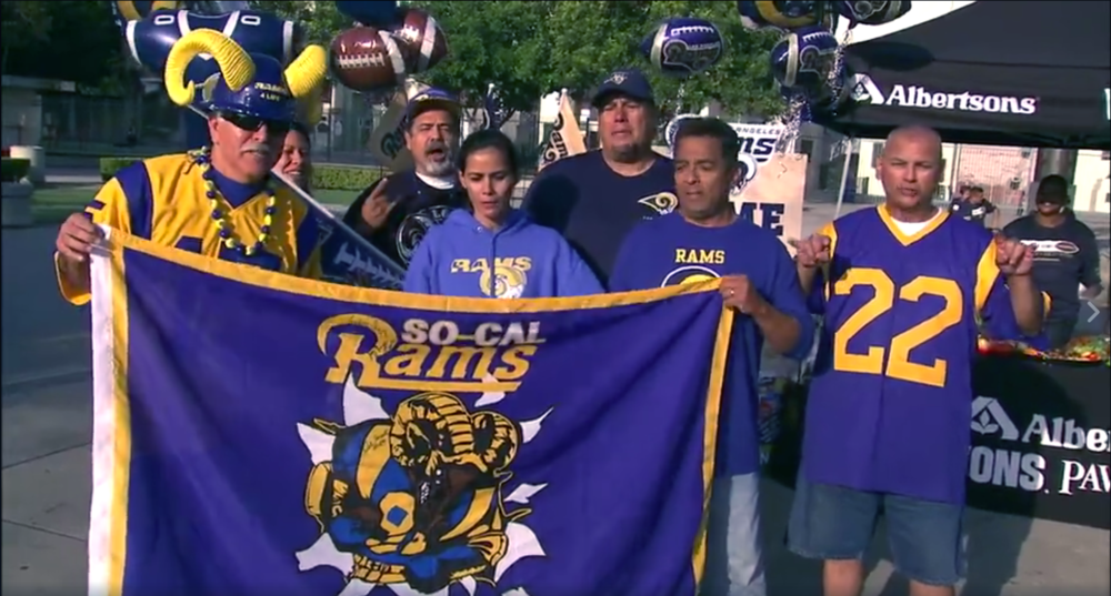 Fox Ch.11 Good Day LA Reporter,  Mario Ramirez  w/ some staff members of the So Cal Rams Booster Club in the background. (2016)   Click on image for video