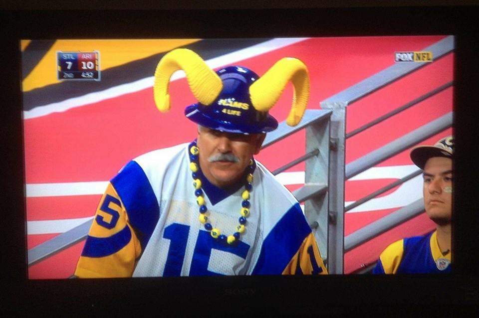 "Staff Member  Joe ""Silver Fox"" Ramirez , wearing the hard hat with horns during the Rams vs. Cardinals on a National televised game on Fox Channel 11. (2014)"