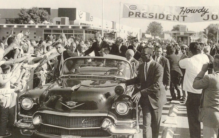 This photo of Robert Roy Faison (Right, front) guarding President Lyndon B. Johnson's car was featured in Shala's article about the first African-American secret service agent.