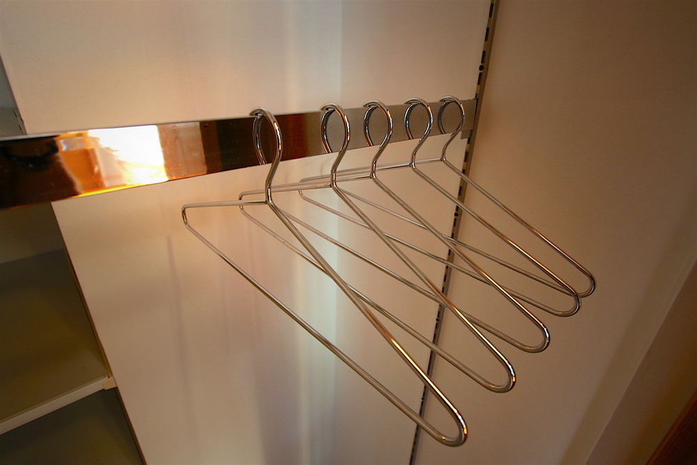 Height-adjustable, chromed, commercial clothes rods...