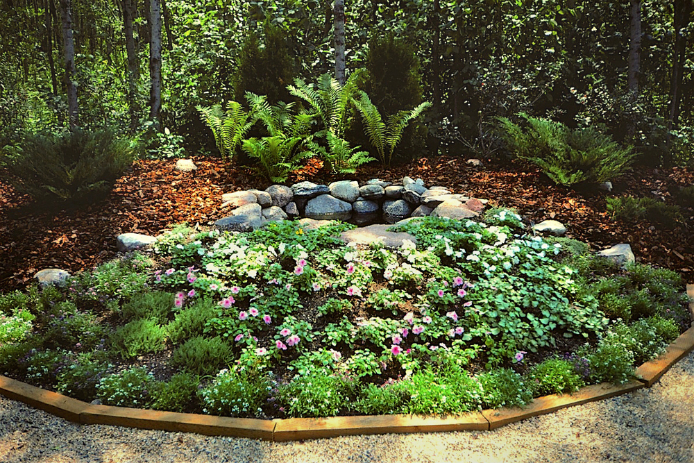 A small pond (replete with waterproof liner, fountain, and lights) was installed adjacent to the  meditation area  to the south-west of Solace House.