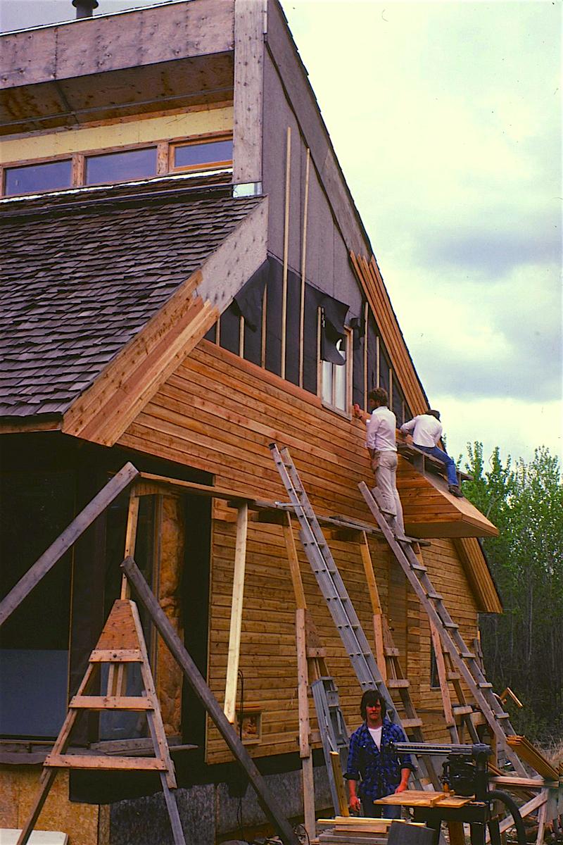 Installation of Western red cedar siding... spring, 1981.
