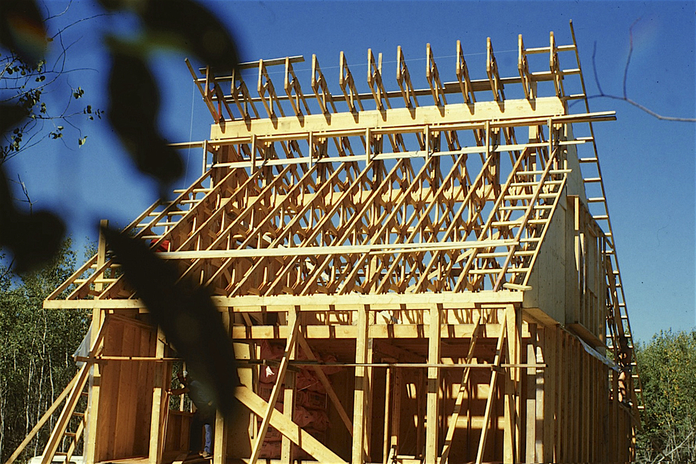 Solace House with structure in place (a hybrid of double-wall framing and post-and-beam), incorporating the site-built web trusses...