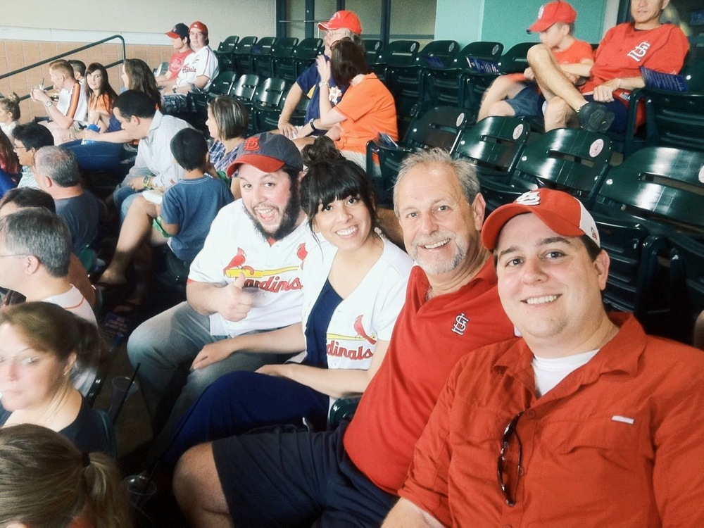 Here we are with Dave's Dad (Mike) and brother (Ryan).  I guess if I  wasn't  a Cardinals fan, family outings like this one wouldn't be quite as fun. ;)