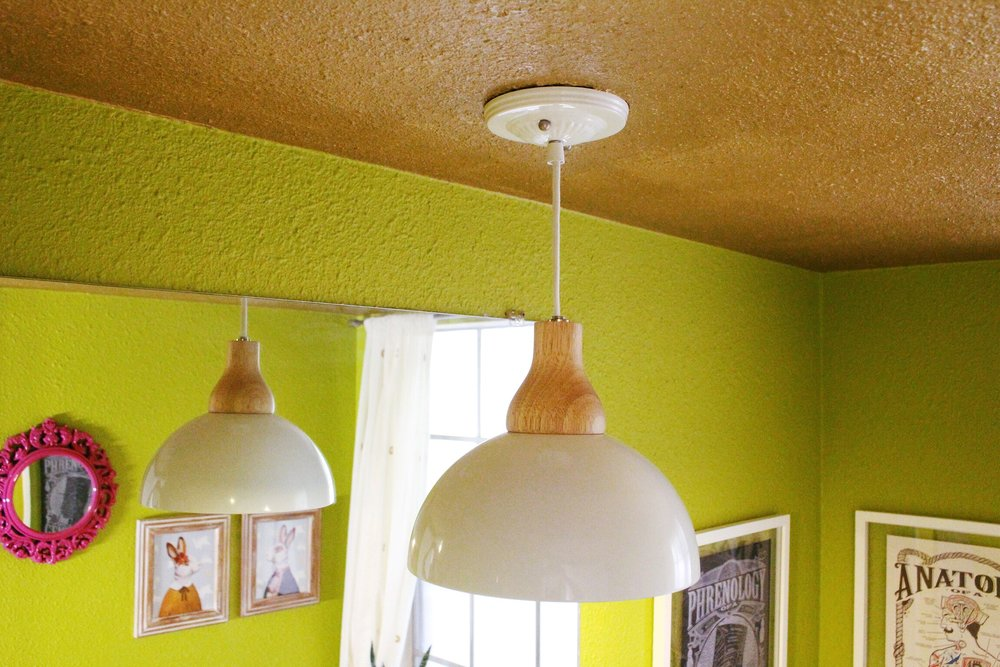This lamp is from Urban Outfitters and he works out perfectly even with our low ceilings. Speaking of ceilings, ours is metallic gold y'all! It's one of my favorite parts of the whole little room.