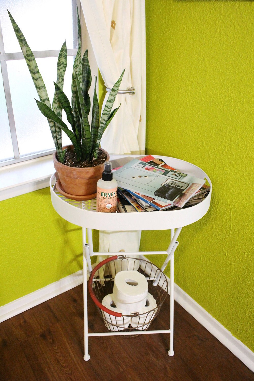 This table and the basket below it are from   At Home  . I feel like I snagged the table out of the outdoor section but whatevs. It was originally lime green so I spray painted it white.