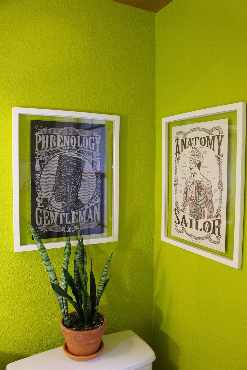 These cool prints   were Dave finds also from Etsy and I love the manly vibes they bring to this room.