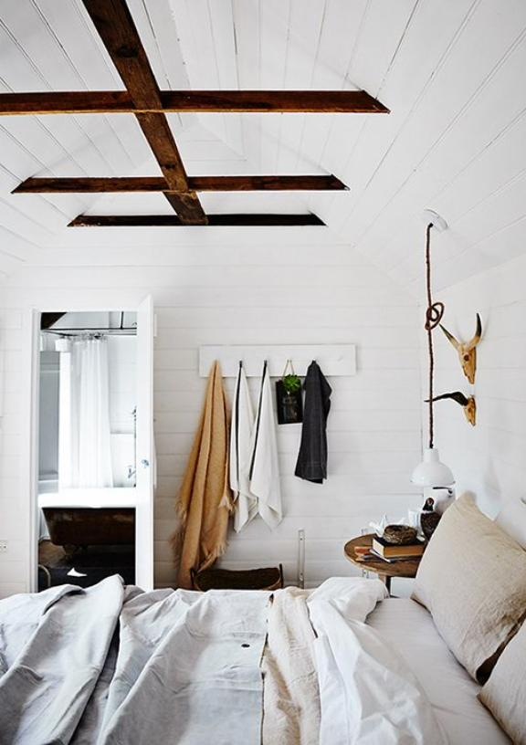 Coziest looking  bedroom  with gorgeous beamed ceiling