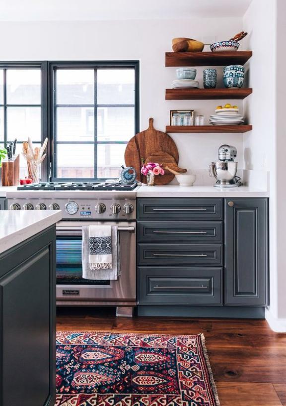 LOVING the color of the cabinetry - it pairs so well with the crisp countertops and walnut open shelving. The rug alludes to the blue cabinets while also introducing a new color to the palate. #FIRSTPLACE (source)
