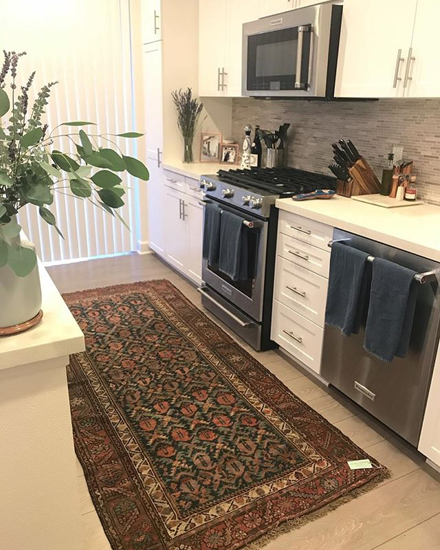 "Happy Friday!! I am so in love with my new kitchen runner from Nicki at @heirlooms.co 👏🏼🙌🏼👍🏼 It is seriously makes me so happy everytime I see it! Swipe to see the placeholder we had before - felt too skinny for the space. My ""new"" runner is a vintage Persian rug from 1910 and is much better scaled for the space. Plus - I love the depth and eclectic look it helps develop in this otherwise blank-slate kitchen :) Vintage rugs are always worth it 🙌🏼 they add so much history and character to a space. I love thinking of the stories this rug has heard over the years and and can't wait to make new memories with it! Now do yourself a huge fave and check out @heirlooms.co!! 👏🏼👏🏼👏🏼 More rug into in story highlights 😘 #vintagerugs #heirloom #designworthy"