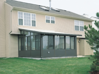 C  Solid roof lean-to style sunroom