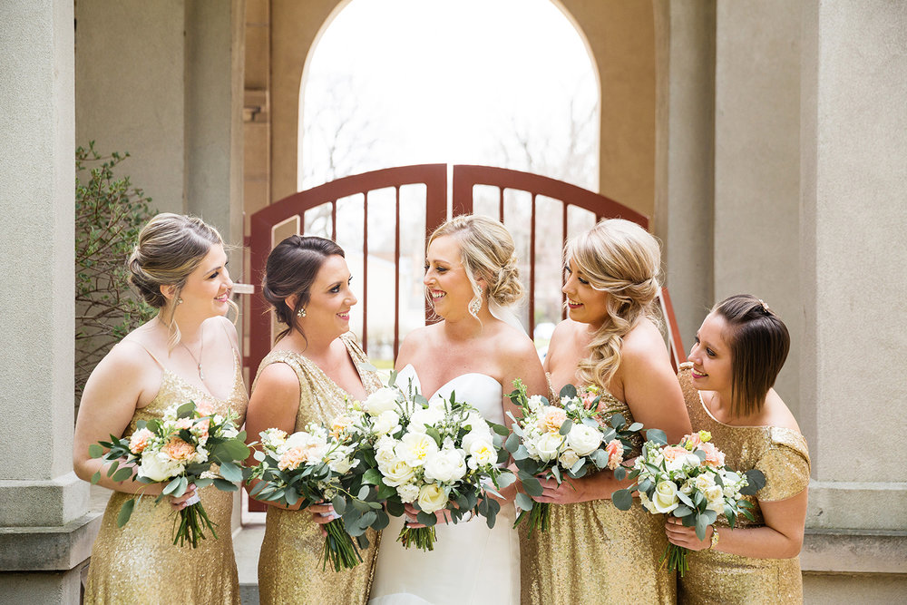 Gold and white bridesmaid bouquets