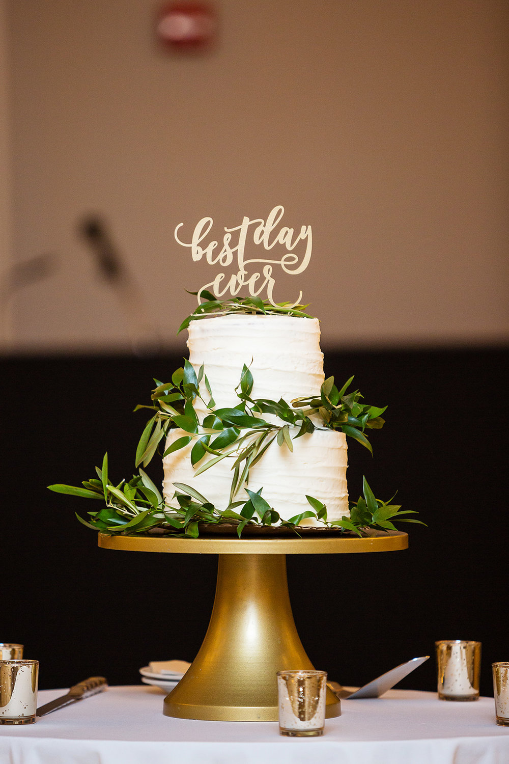 Textured buttercream greenery wedding cake