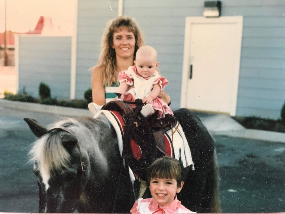 That bald baby... yeah, thats me! And check out my hot mama and super cute Sis.