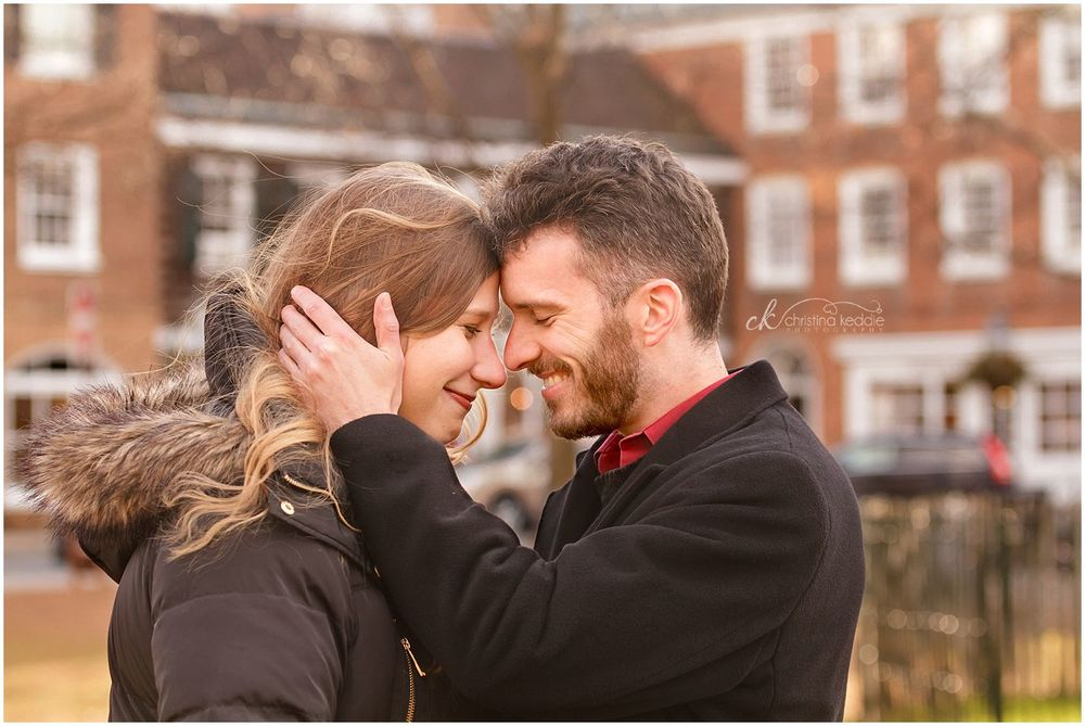 Engagement portrait in winter coats and romantic pose | Christina Keddie Photography | Princeton NJ engagement photographer
