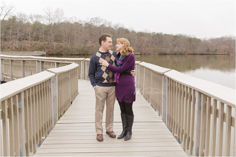 Engaged couple on bridge over lake | Christina Keddie Photography | Historic Smithville Park engagement photographer