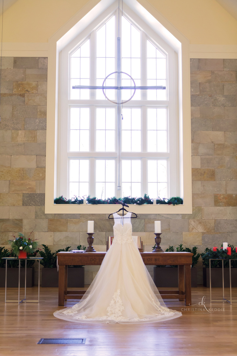 Wedding gown displayed in church sanctuary at altar | Christina Keddie Photography | Princeton NJ wedding photographer