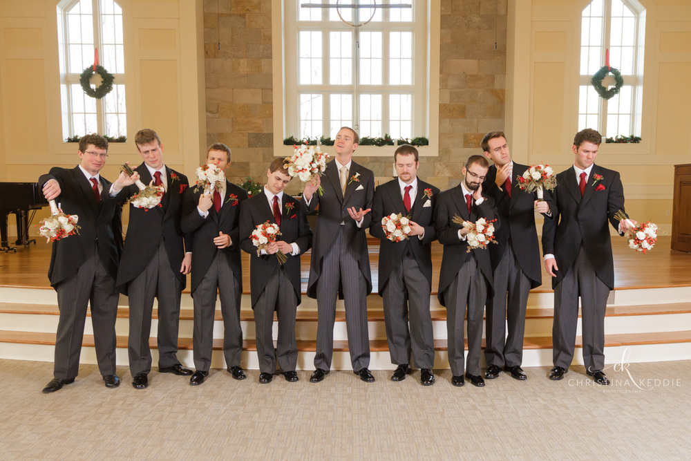 Groom and groomsmen funny photo with bouquets | Christina Keddie Photography | Princeton NJ wedding photographer