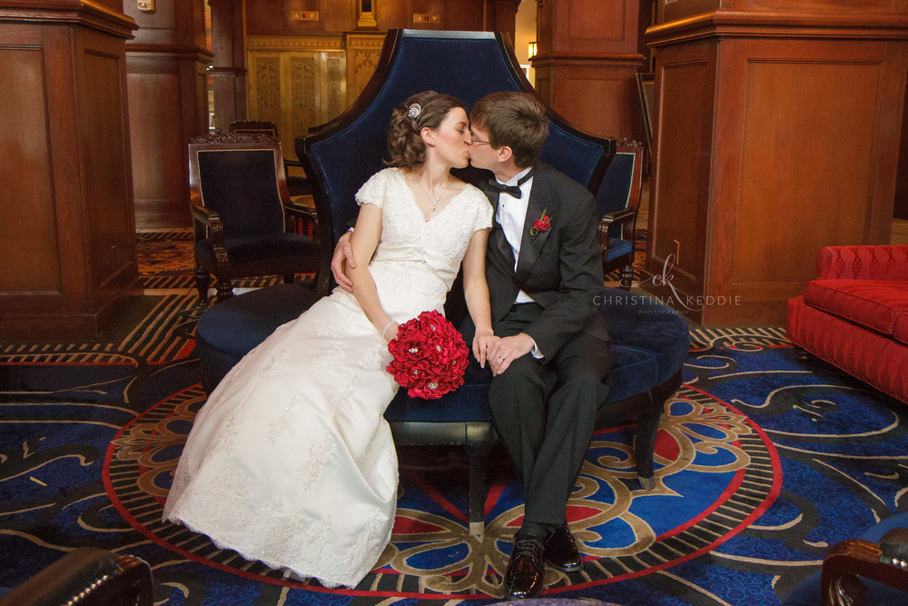 Bride and groom kissing in lavish hotel lobby | Christina Keddie Photography | Princeton NJ wedding photographer