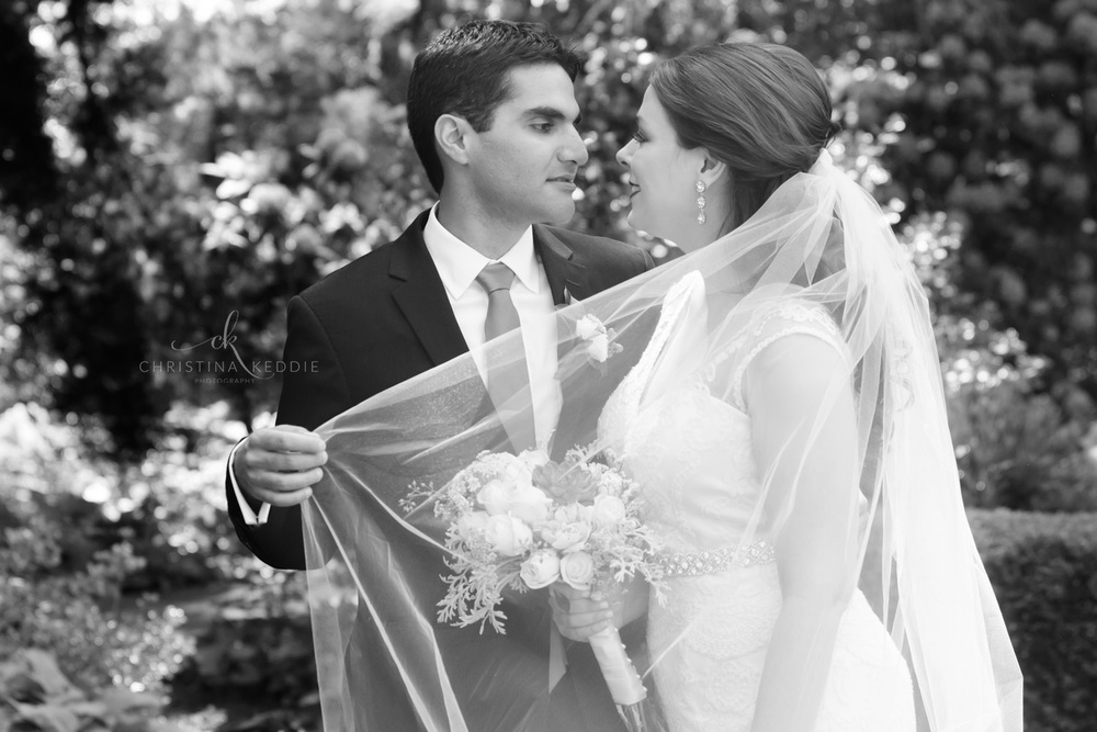 Bride and groom stolen moment in garden with veil | Christina Keddie Photography | Princeton NJ wedding photographer