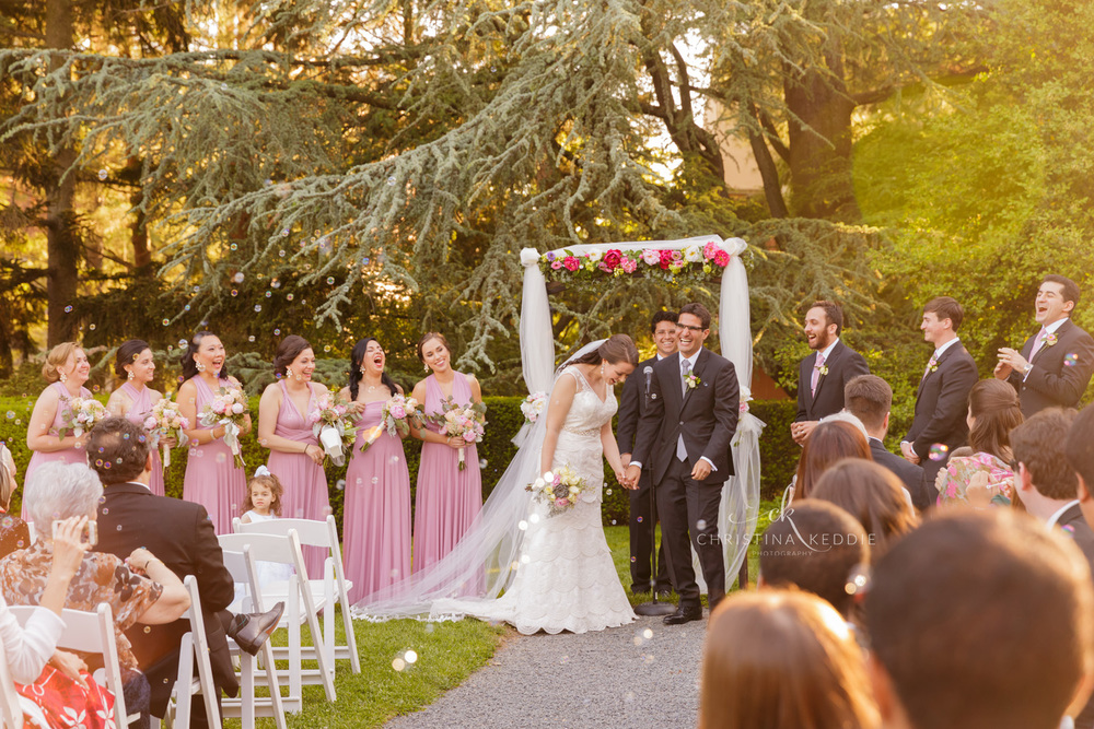 Wedding ceremony laughter in rose garden | Christina Keddie Photography | Princeton NJ wedding photographer