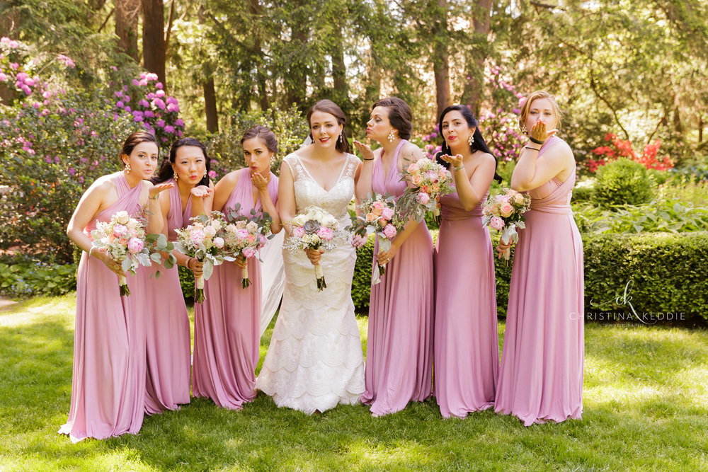 Bride and bridesmaids blowing kisses in garden | Christina Keddie Photography | Princeton NJ wedding photographer