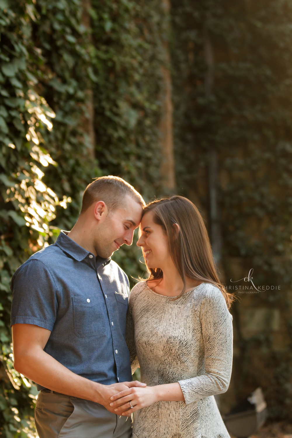 Engaged couple embracing against ivy-covered wall | Christina Keddie Photography | Princeton NJ engagement photographer
