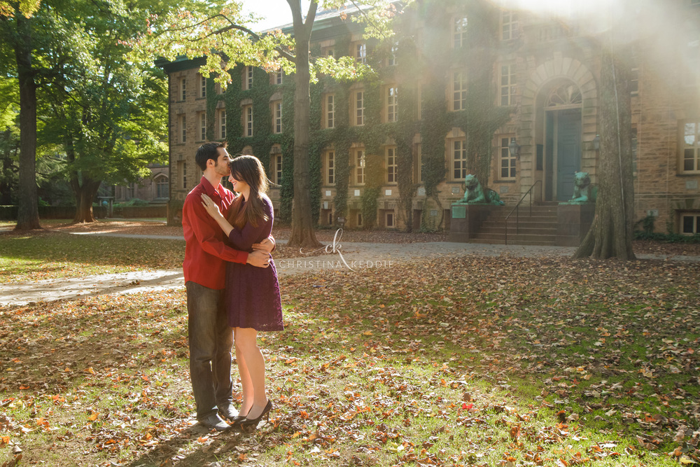 Engaged couple in sunlight in front of Nassau Hall | Christina Keddie Photography | Princeton NJ engagement photographer