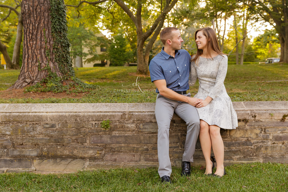 Engaged couple sitting on stone wall | Christina Keddie Photography | Princeton NJ engagement photographer