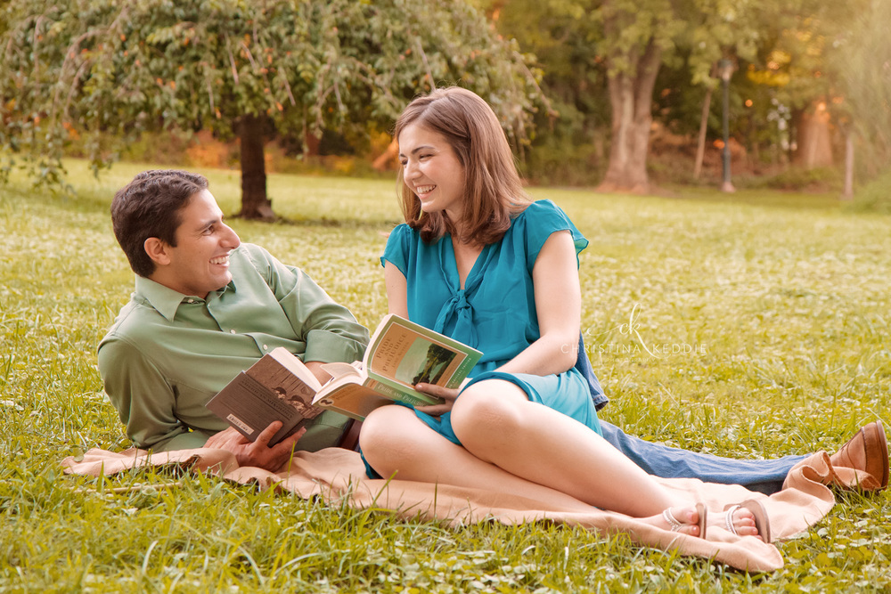 Engaged couple reading together on picnic blanket | Christina Keddie Photography | Hopewell NJ engagement photographer