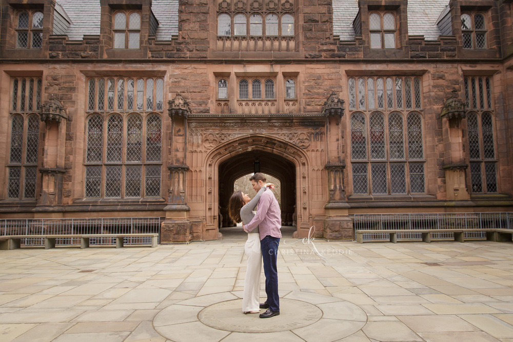 Engaged couple embracing in gothic plaza | Christina Keddie Photography | Princeton NJ engagement photographer