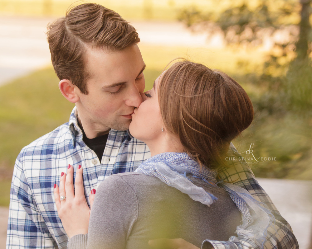 Engaged couple kissing through leaves | Christina Keddie Photography | Princeton NJ engagement photographer