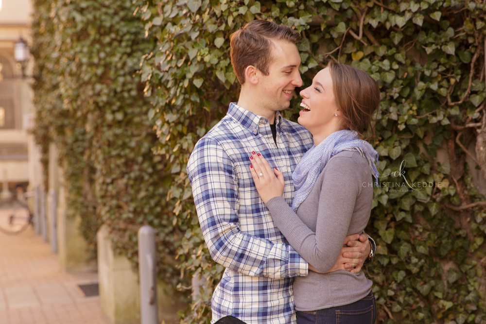 Engaged couple laughing in front of ivy-covered wall | Christina Keddie Photography | Princeton NJ engagement photographer