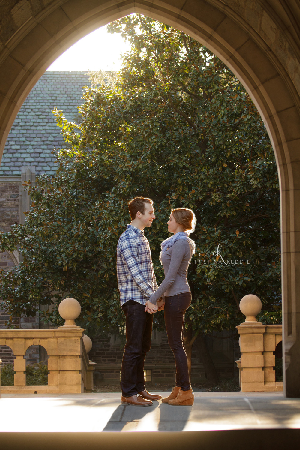 Engaged couple sunlit under gothic archway | Christina Keddie Photography | Princeton NJ engagement photographer