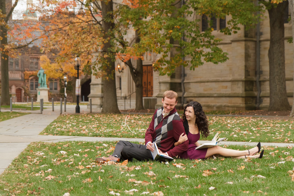Engaged couple reading together on university campus | Christina Keddie Photography | Princeton NJ engagement photographer