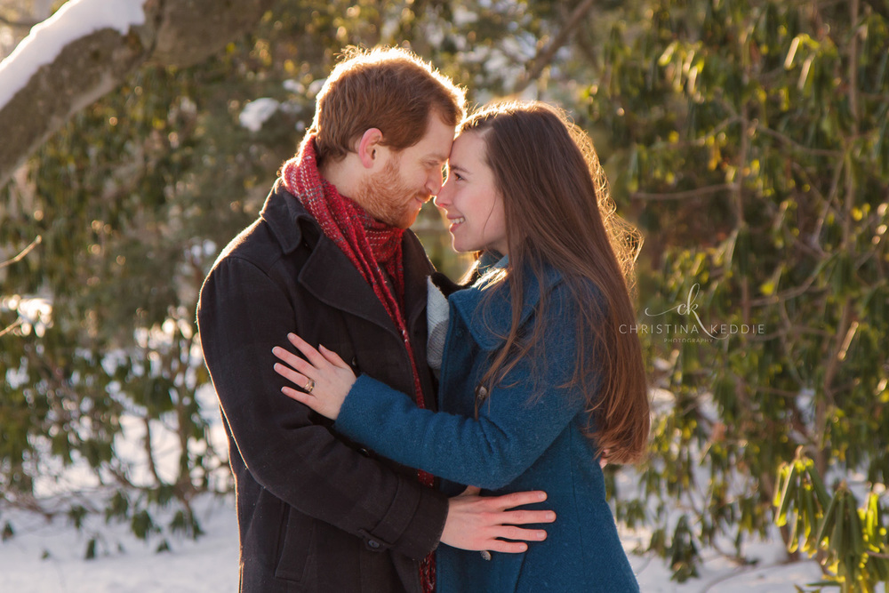 Engaged couple embracing in the snow | Christina Keddie Photography | Princeton NJ engagement photographer