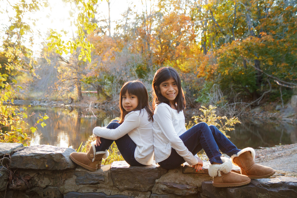 Sisters on stone wall by D&R canal | Christina Keddie Photography | Princeton NJ family photographer