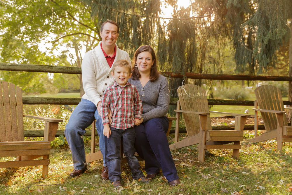 Family with toddler boy in sunlit backyard | Christina Keddie Photography | Skillman NJ family photographer