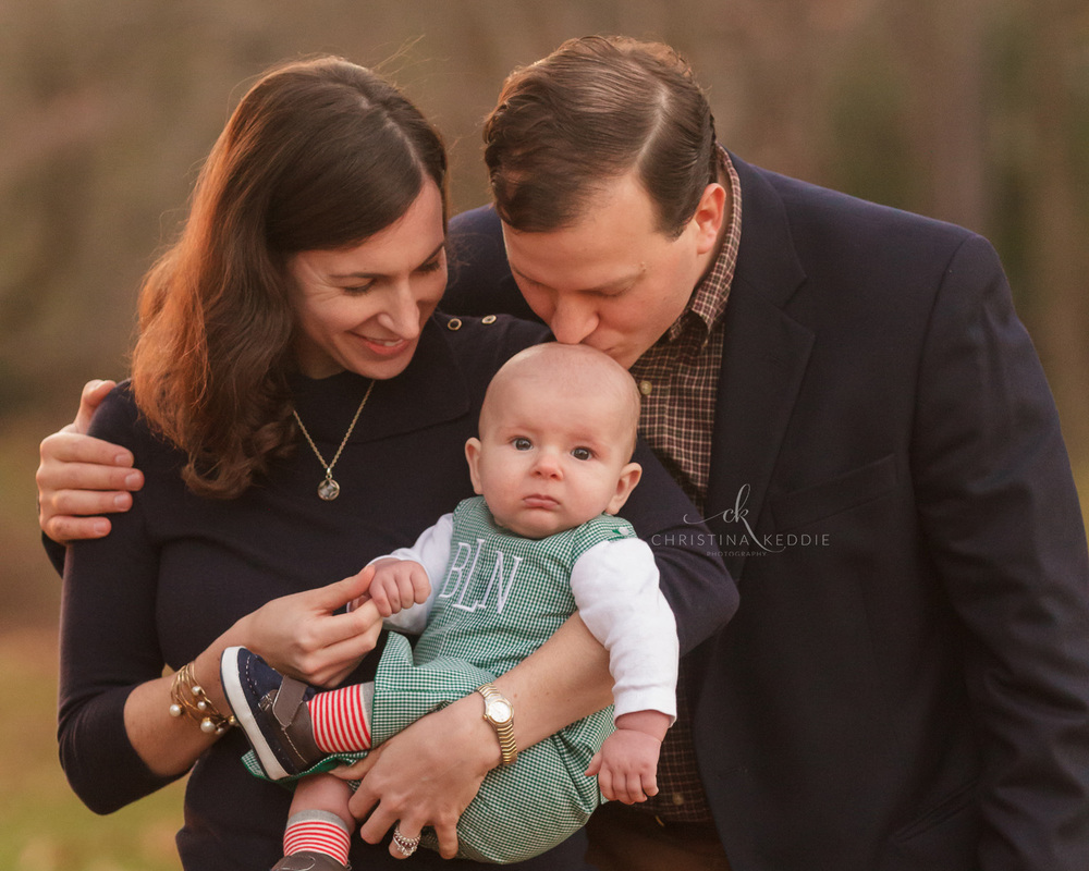 Parents kissing four-month-old son | Christina Keddie Photography | Princeton NJ family photographer