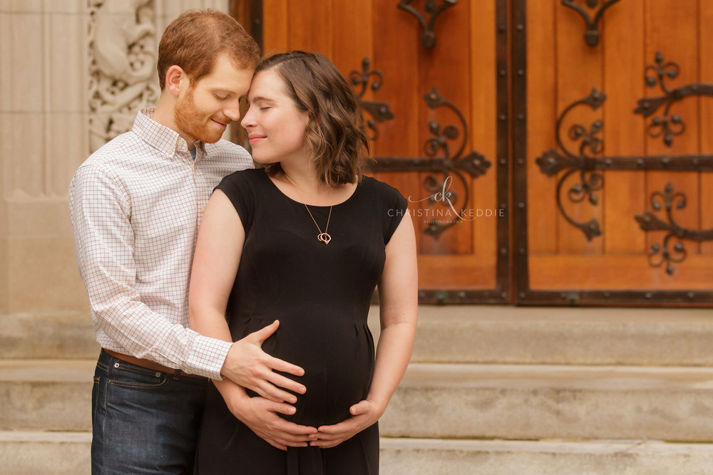 Maternity portrait in front of ornate wooden door | Christina Keddie Photography | Princeton NJ maternity photographer