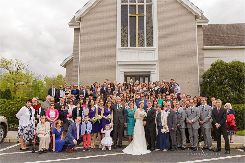 Group photo of all wedding guests in front of church | Christina Keddie Photography | Cherry Hill NJ wedding photographer