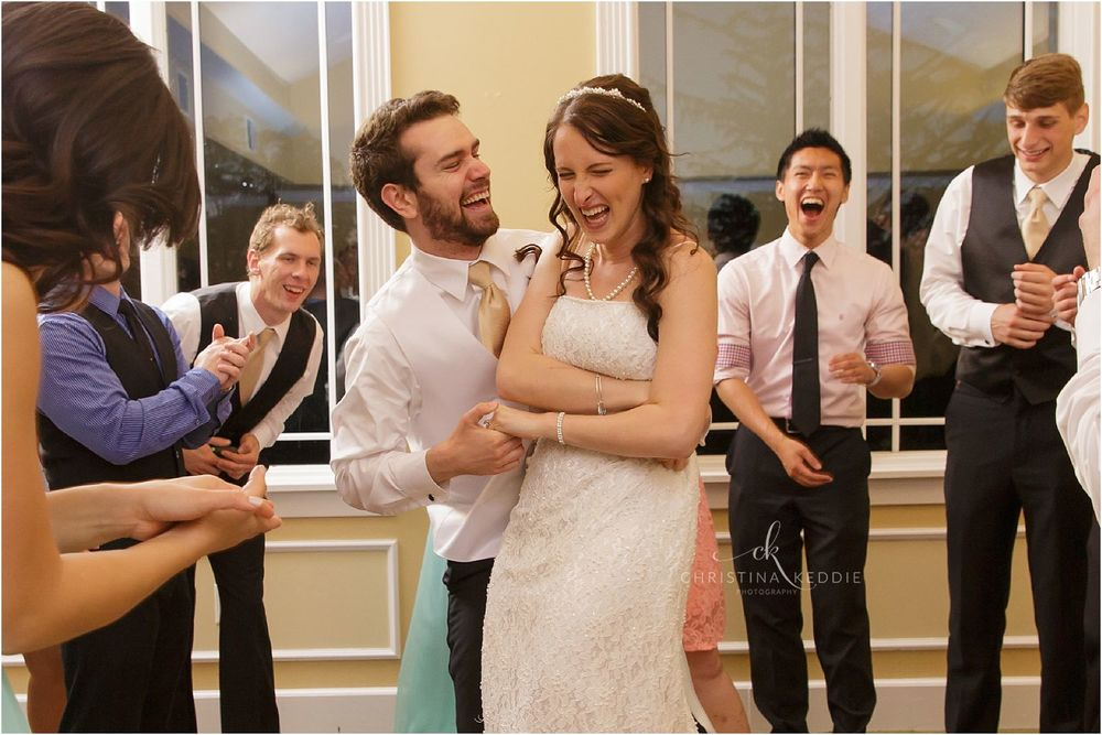 Laughing bride and groom on dance floor | Christina Keddie Photography | Ewing NJ wedding photographer